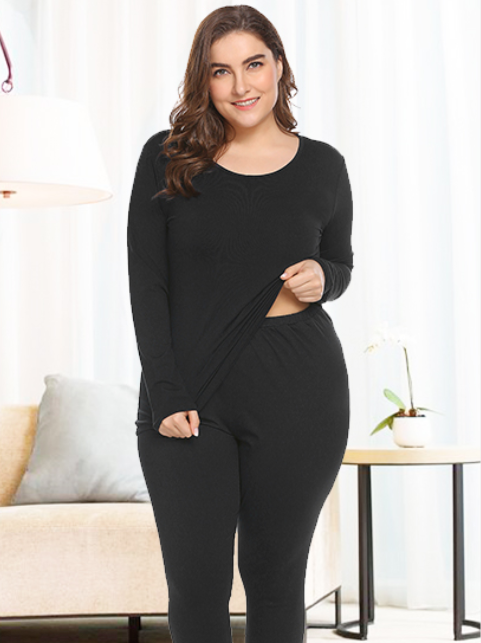 A person wearing matching black thermal leggings and a long-sleeved thermal top