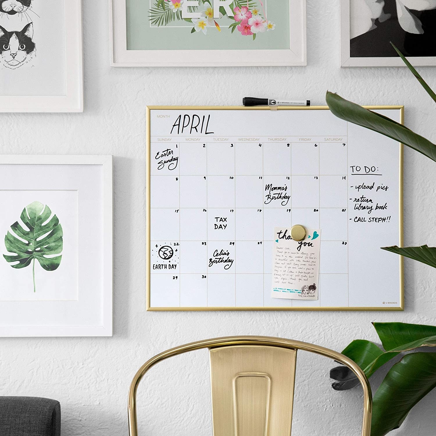 The gold framed magnetic white board hung on a wall with examples of calendar markings and a separate column for to-do lists