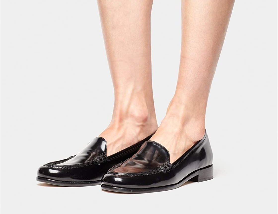 The legs of a model, against a white backdrop, wear the Tabitha Simmons 'Blakie' round toe loafer.