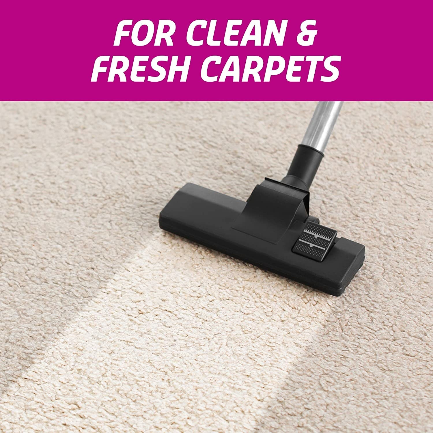 Clean patch of dirty carpet following the head of a vaccuum cleaner