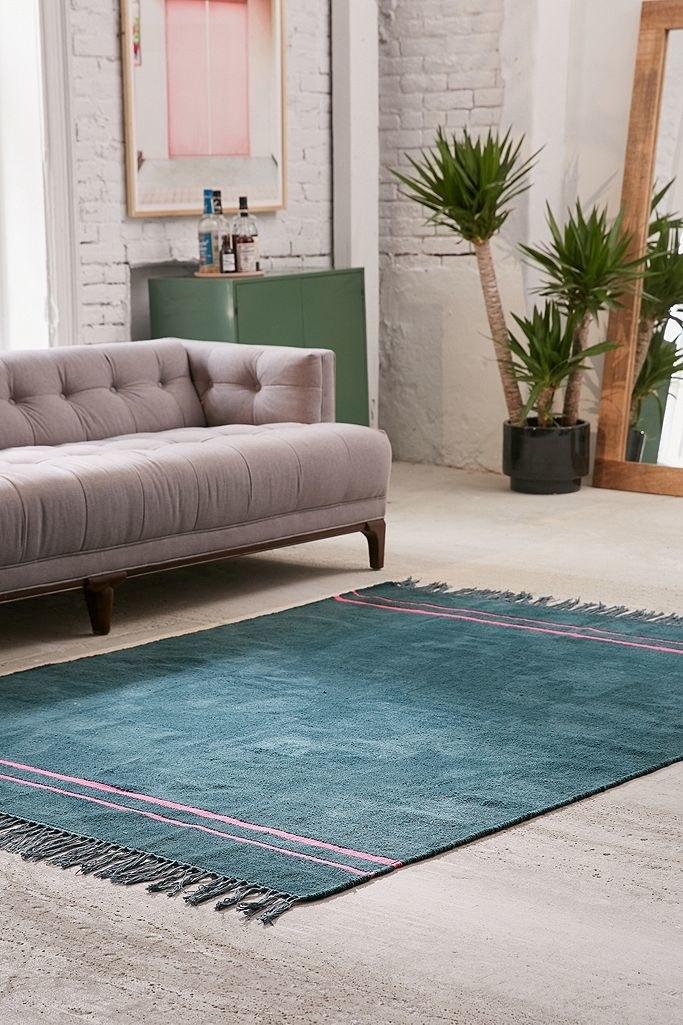 Blue rug on a floor