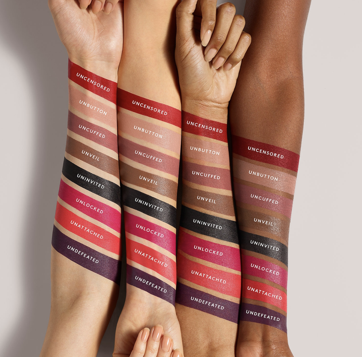 Eight lipstick swatches in colors including red, pinks, and even black and violet across arms with light, medium, tan, and deep skin tones