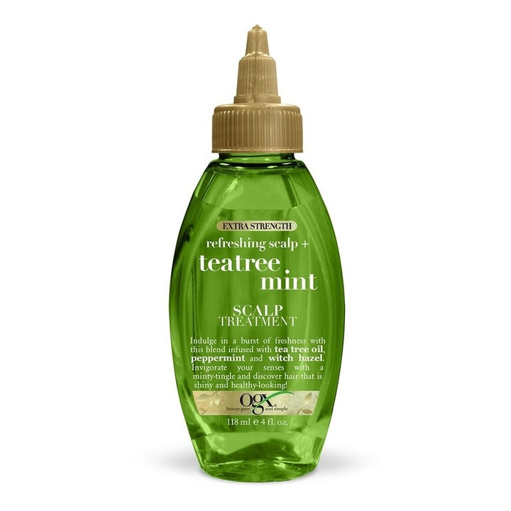 """green bottle with brow nozzle labeled """"teatree mint"""""""