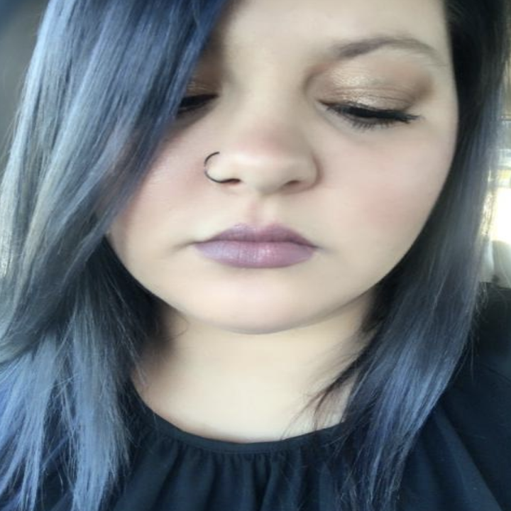 person with shiny and healthy-looking light blue hair