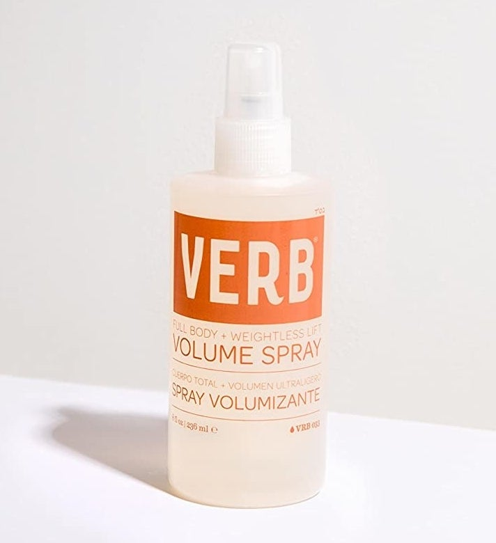 "white and orange bottle labeled ""verb volume spray"" with spray nozzle"