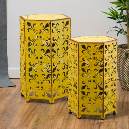 two yellow antique style side tables in hexagon shape with floral cutouts on the sidew
