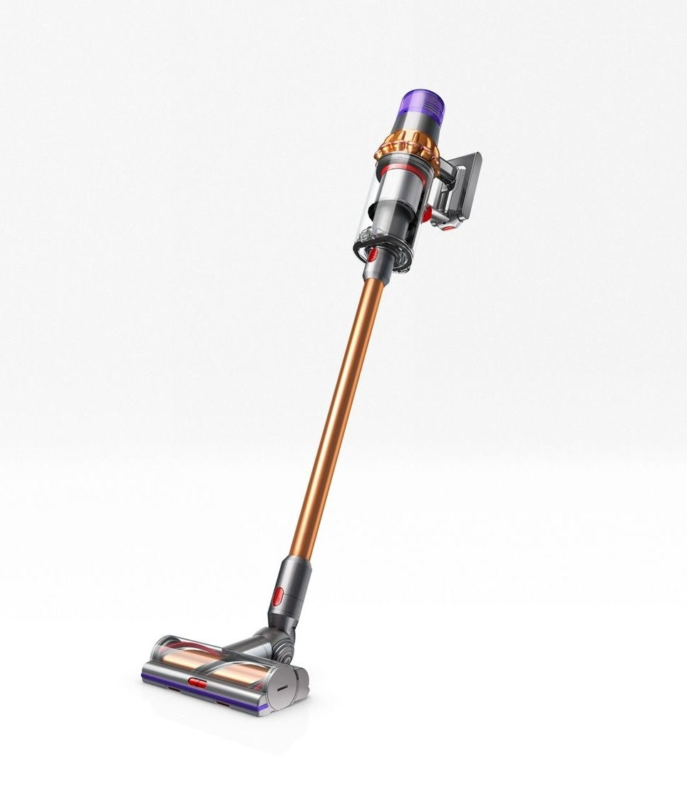 The copper colored Dyson V11 Torque Drive cordless vacuum in front of a neutral background