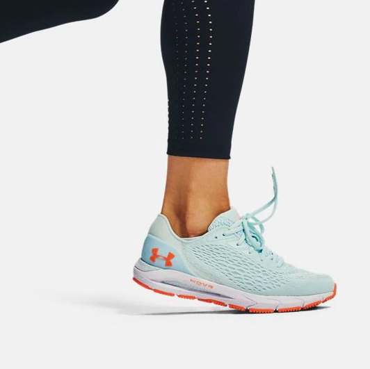 Running shoes in orange and teal colorway