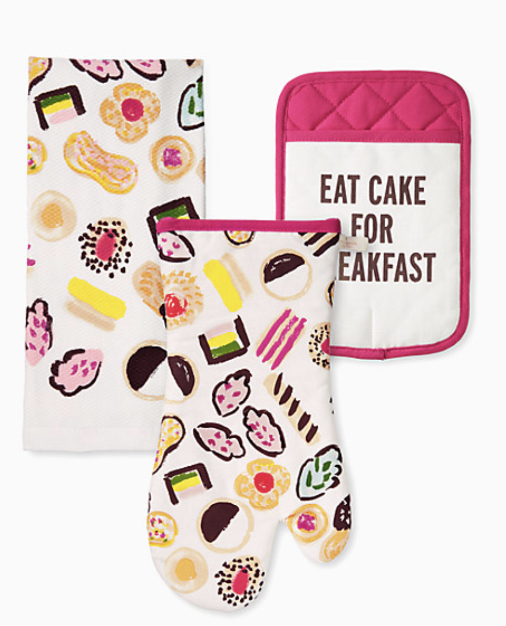 "Flatlay of the dishtowel and oven mitt with illustrated sweets on them and a potholder that reads ""Eat Cake For Breakfast"""