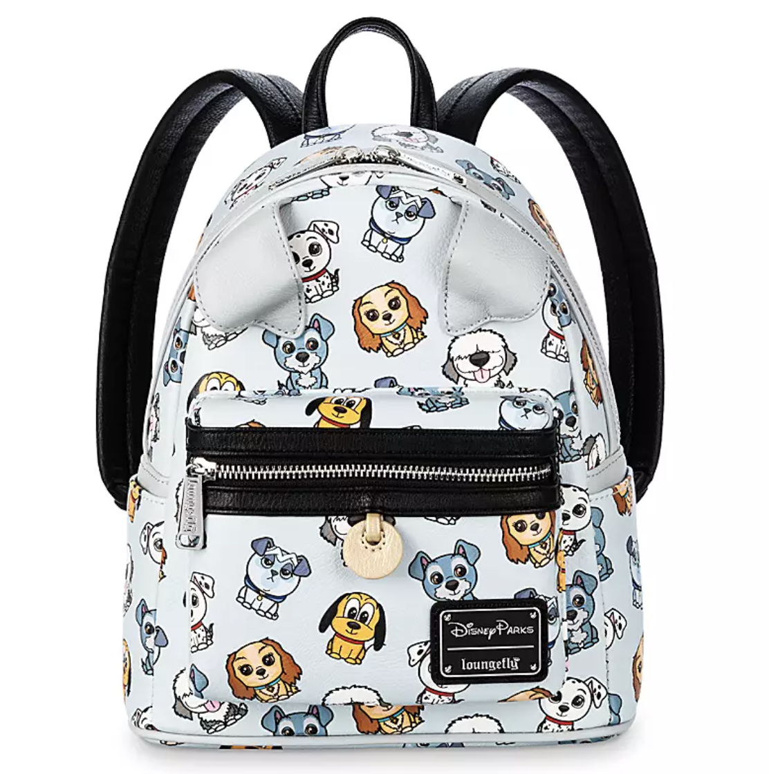 a pale blue mini back pack with black straps, a black zippered front pocket, subtle folded over dog ears, and an all-over pattern of various dogs from Disney films