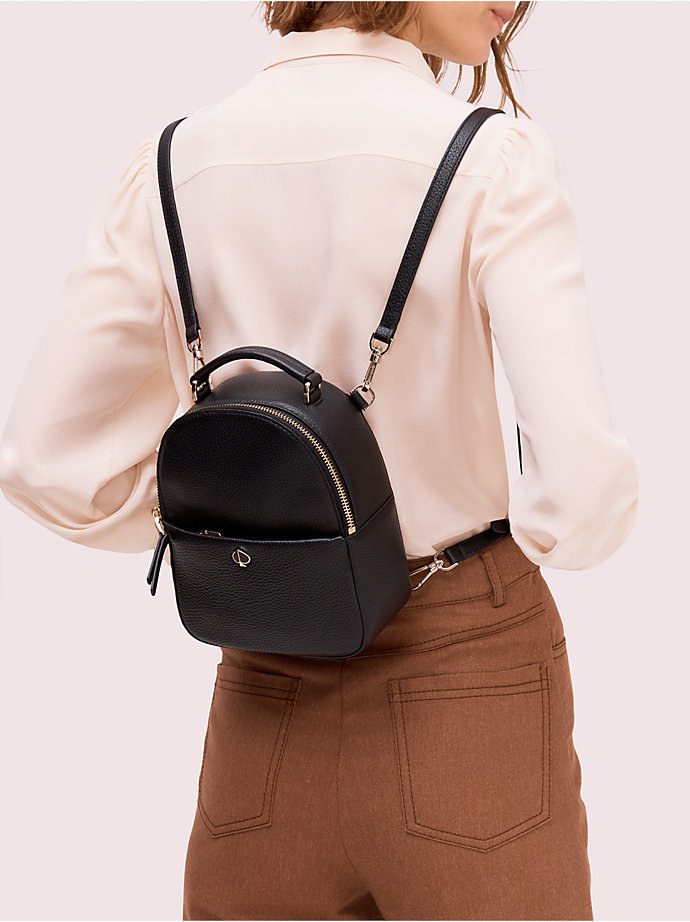 Model wearing the black small backpack on her back