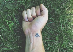 The Deathly Hallows symbol on someone's wrist