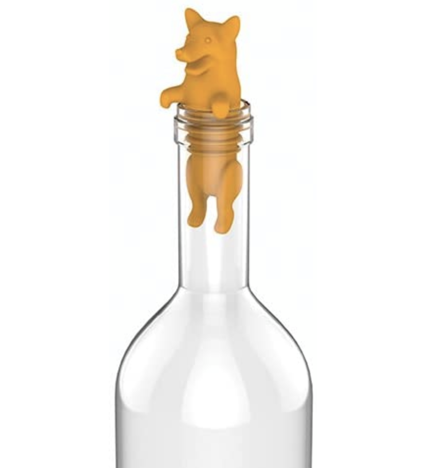 A silicone corgi-shaped wine stopper in a clear bottle to show its little butt hanging out in the bottle's neck and its little paws chilling on top of the bottle's lip