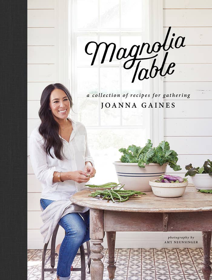 A cookbook cover showing HGTV star and author Joanna Gaines sitting at a table full of vegetables smiling