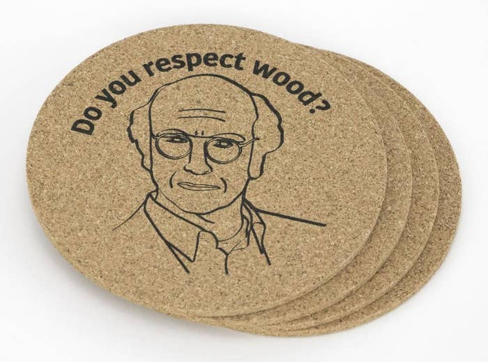 """A pile of four cork coasters that say """"do you respect wood?"""" with Larry David glaring at you"""