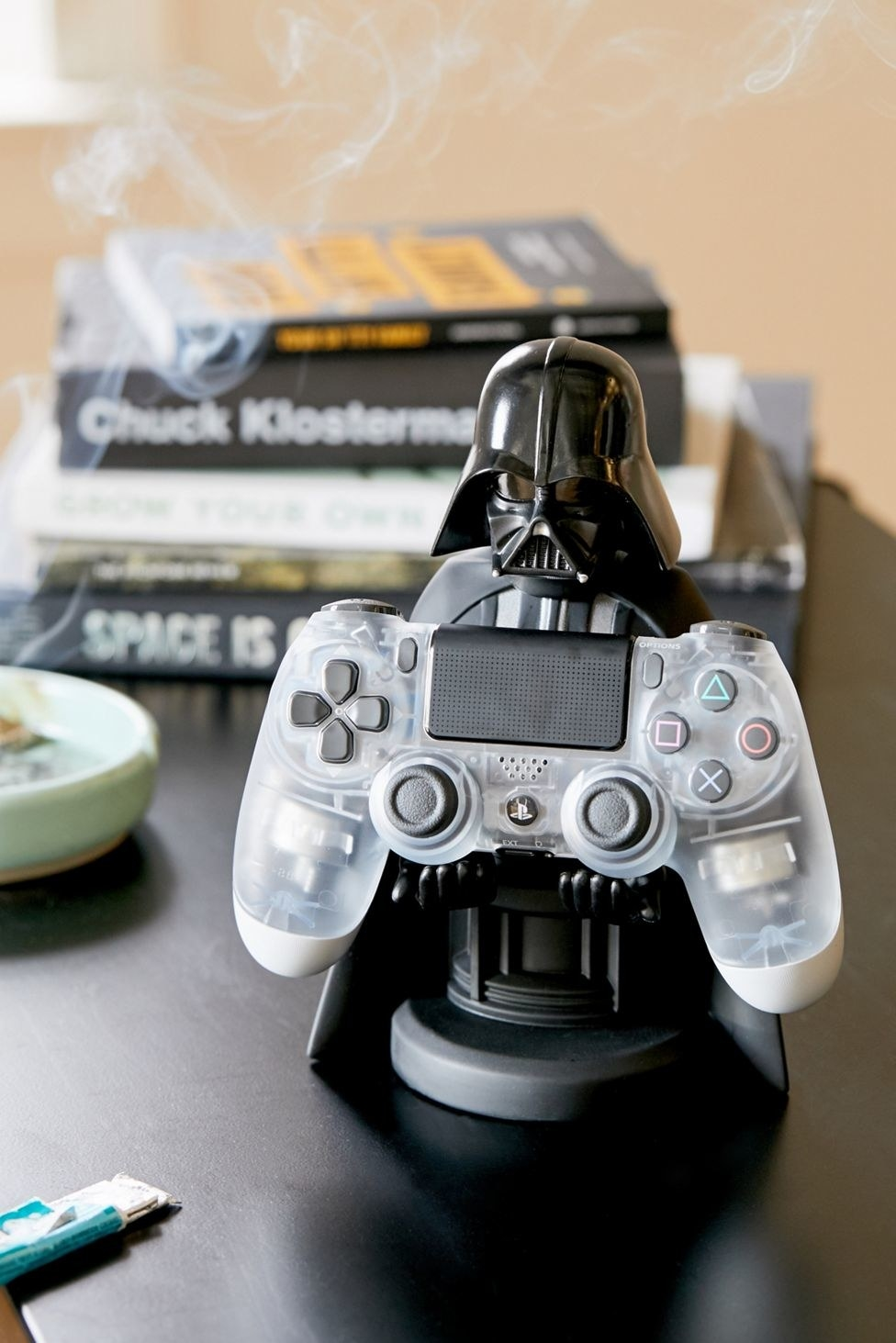 The Darth Vader-shaped device stand holding a game controller