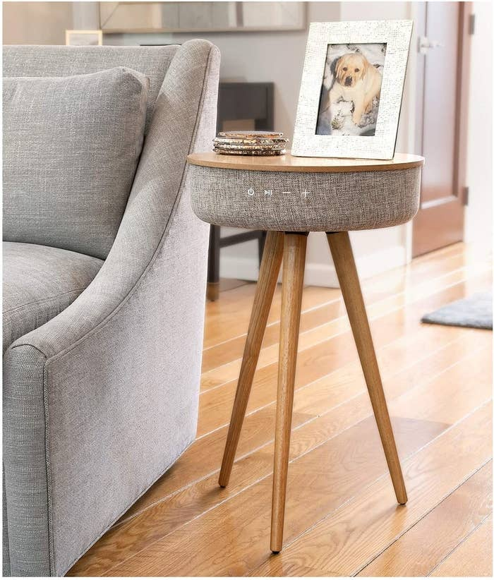 The speaker side table displayed next to sofa in a living room