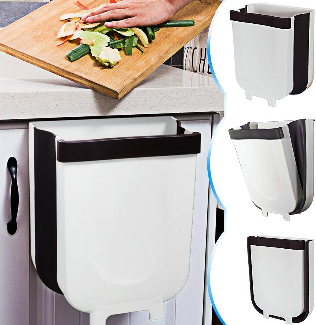 Hand pushing vegetable peels from counter into a bin underneath