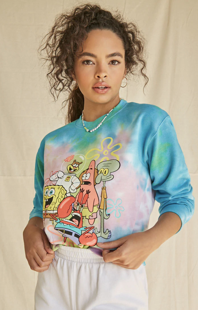 a person wearing a blue, pink, and white tie dye sweatshirt featuring the entire cast of sponge bob on it