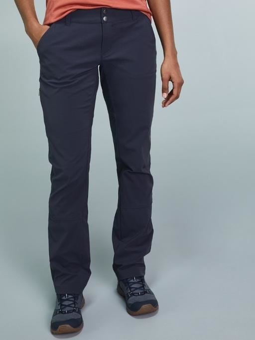 Navy trail pants paired with light blue sneakers and a washed pink top
