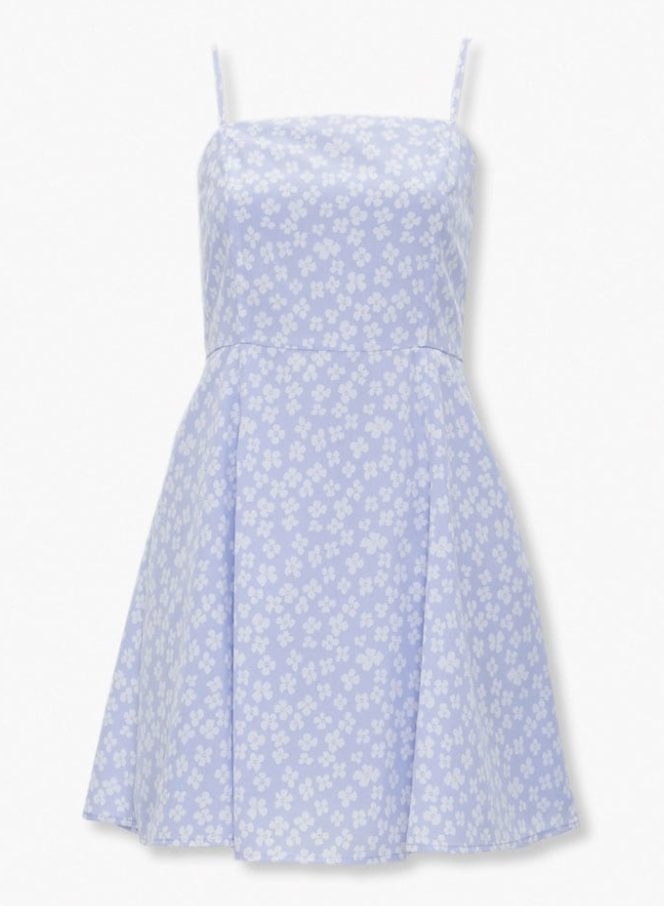 a mini dress in a lavender color covered in white delicate daisy-like flowers