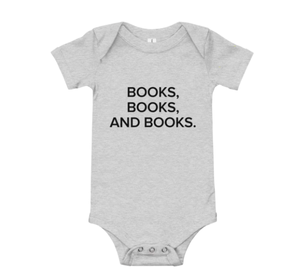 "A gray baby onesie with the quote ""Books, Books, and Books"" in black bold text on the front center"