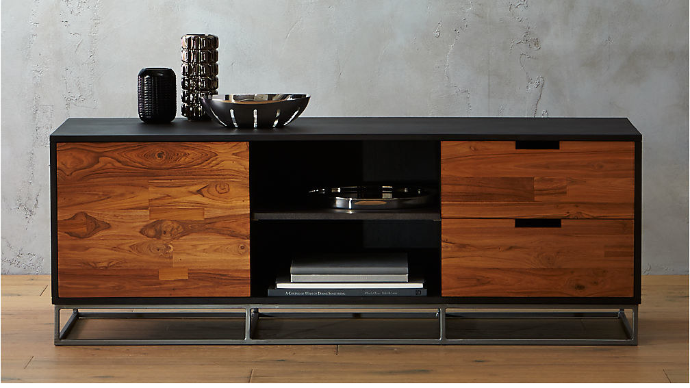A mixed media credenza made of a dark mango wood and teak with an iron base
