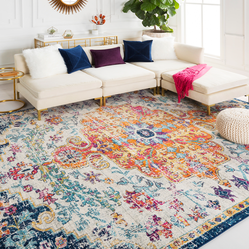 The orange, pink, and blue Bodrum area rug that covers most of the room's floor