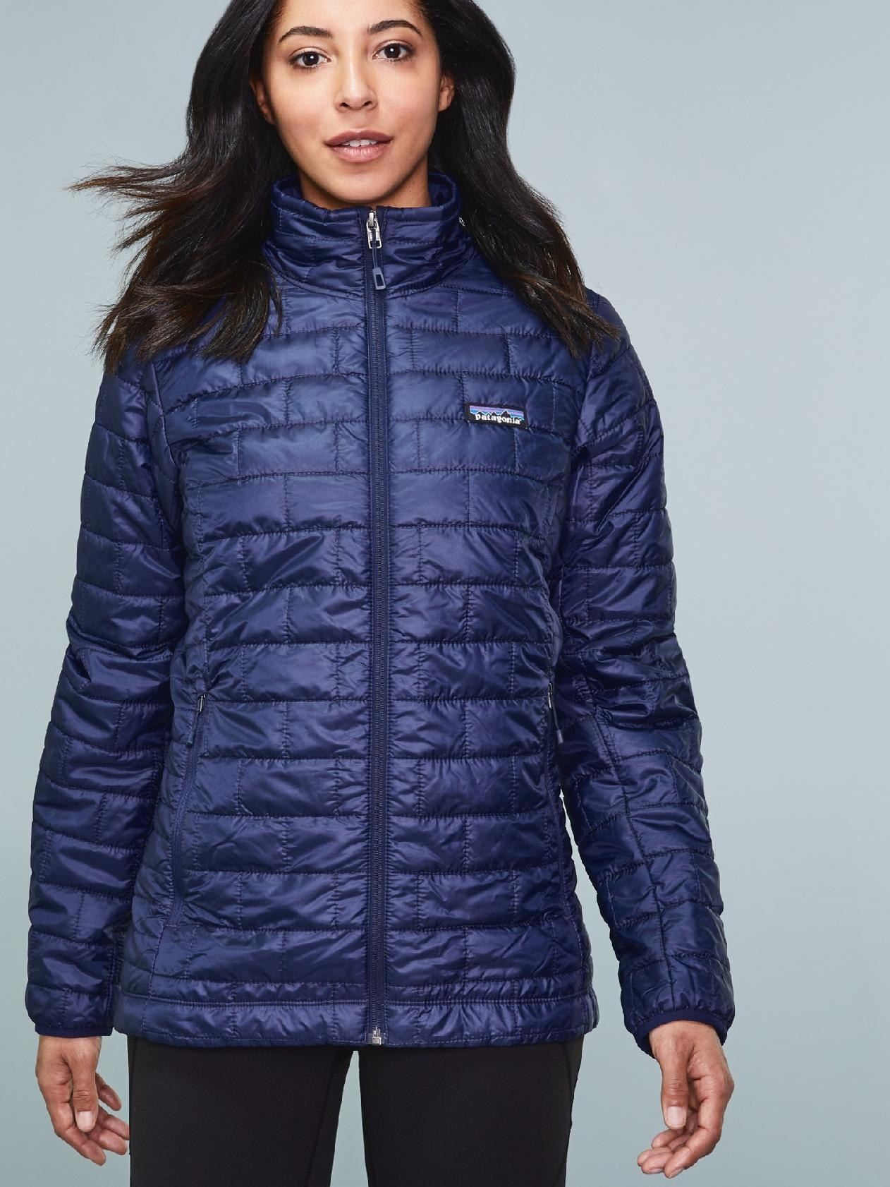 A model wearing the Patagonia Nano Puff Jacket in blue