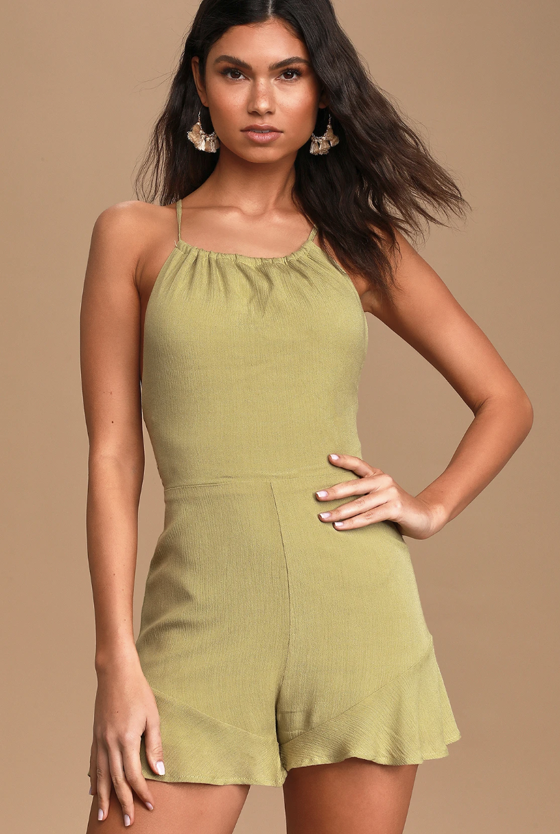 A model wearing a light green romper with a gathered neckline