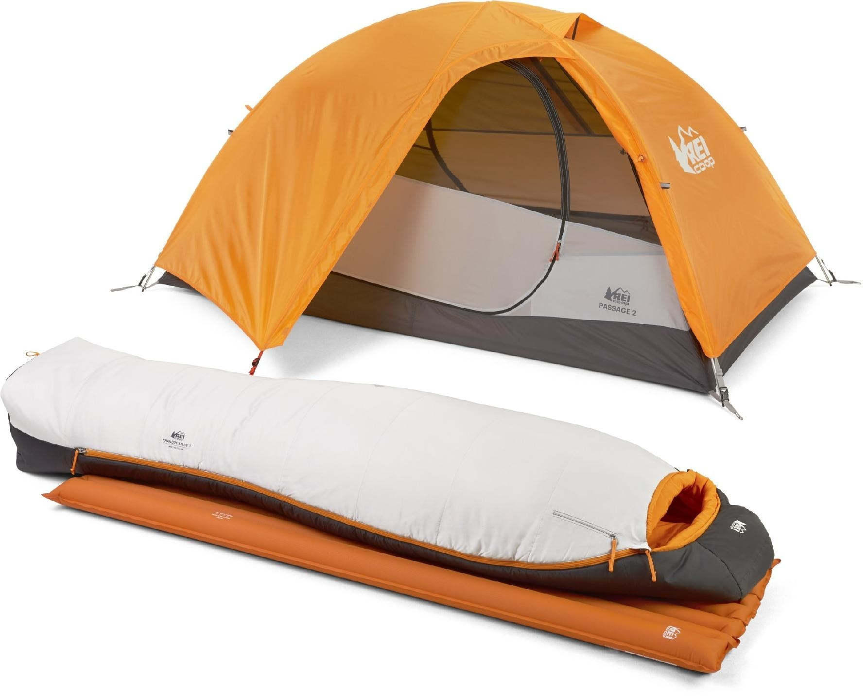 The orange tent, sleeping bag, and sleeping pad on display next to each other