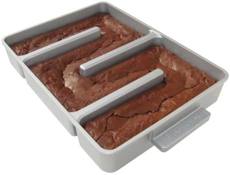 product shot of brownie pan with three dividers that jut out from the sides to the middle so that every piece of brownie has a crispy edge after baking