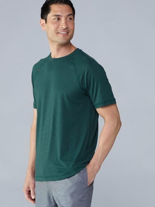 Teal short sleeve tee paired with gray active pants