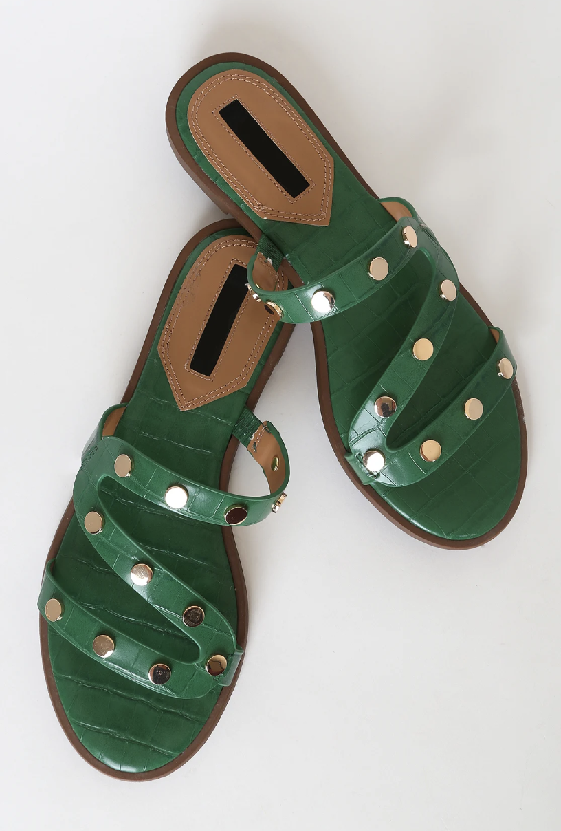 Forest green sandals with brown trim and silver rhinestones dotted across the straps that zig-zag along the front