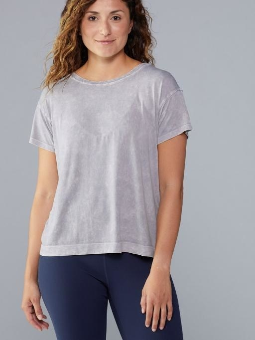 Muted pink tee paired with blue leggings