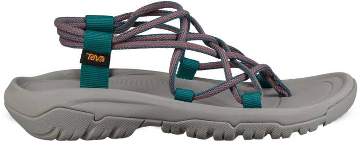 Side view of sandal with pink straps and gray base