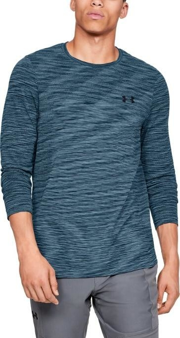 Long-sleeve textured blue shirt paired with gray performance pants