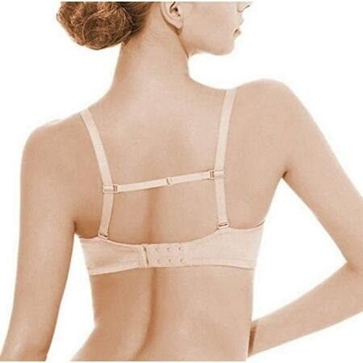 back of model wearing a bra with a strap accessory that's horizontal connecting her two bra straps in the back so they don't slip