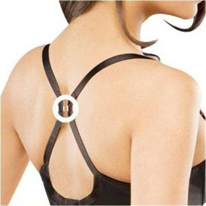 back of a different model wearing a bra clip that joins the two bra straps together to create an X racerback shape