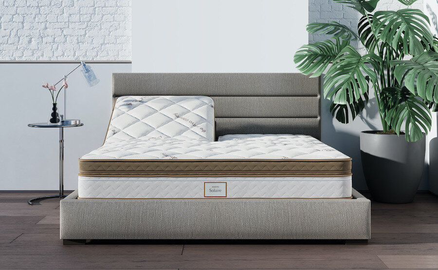 An adjustable Saatva mattress with the left side propped up and the right side lying down