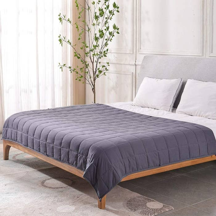 A weighted blanket spread out on a king-sized bed