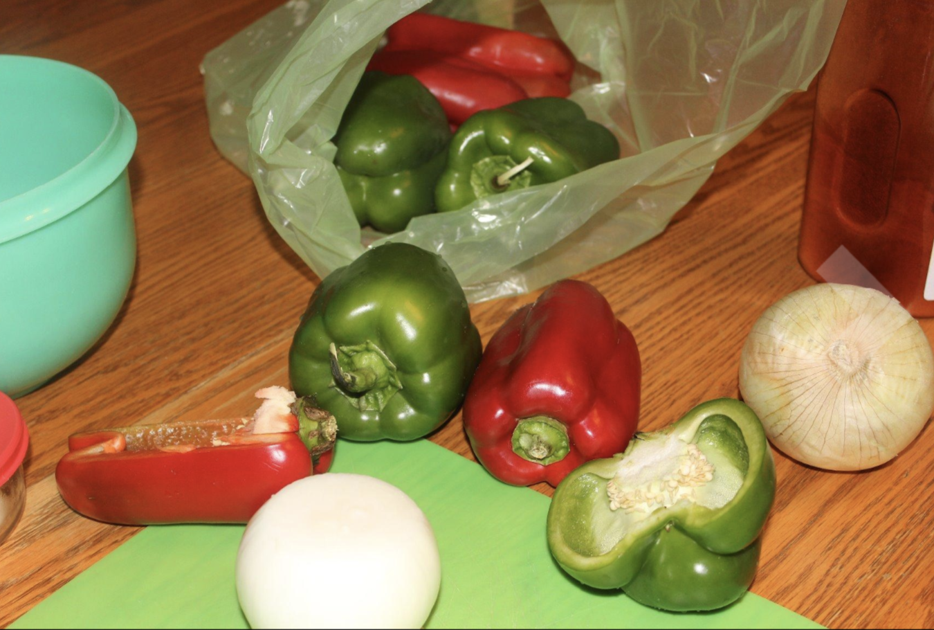 A produce saving bag with peppers inside of it