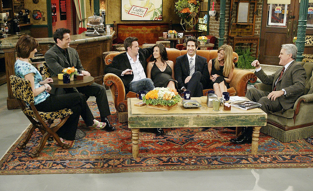 "The cast of ""Friends"" sitting on-set during a 2004 interview."