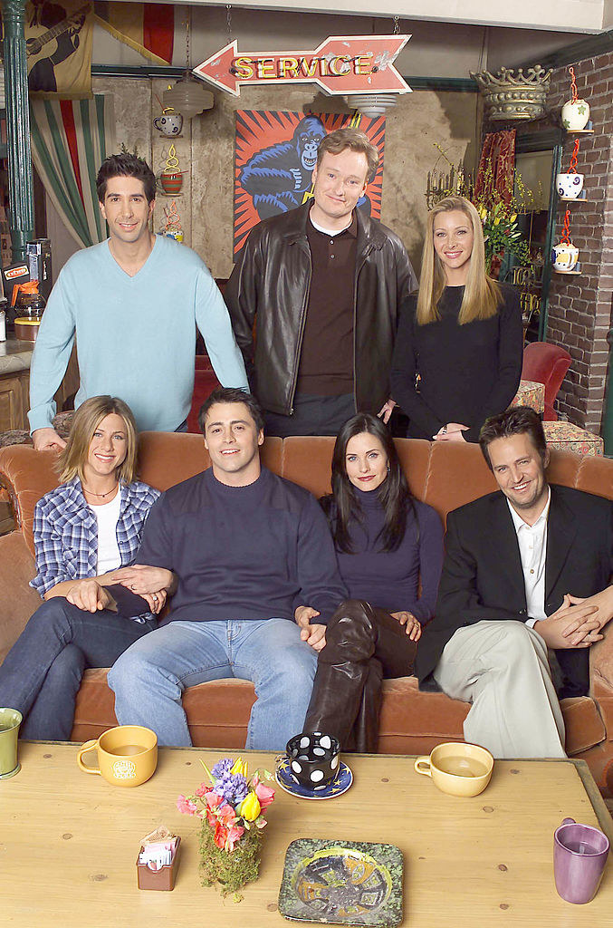 "The cast of ""Friends"" pose for a picture alongside chat show host, Conan O'Brien."