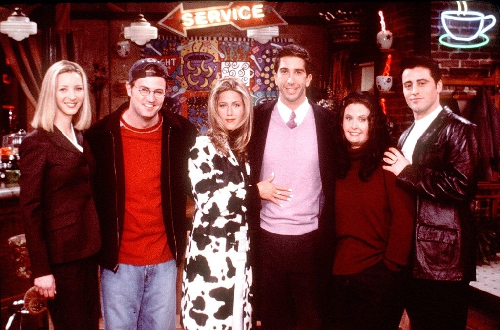 "The cast of ""Friends"" pose for a picture while filming the first episode."