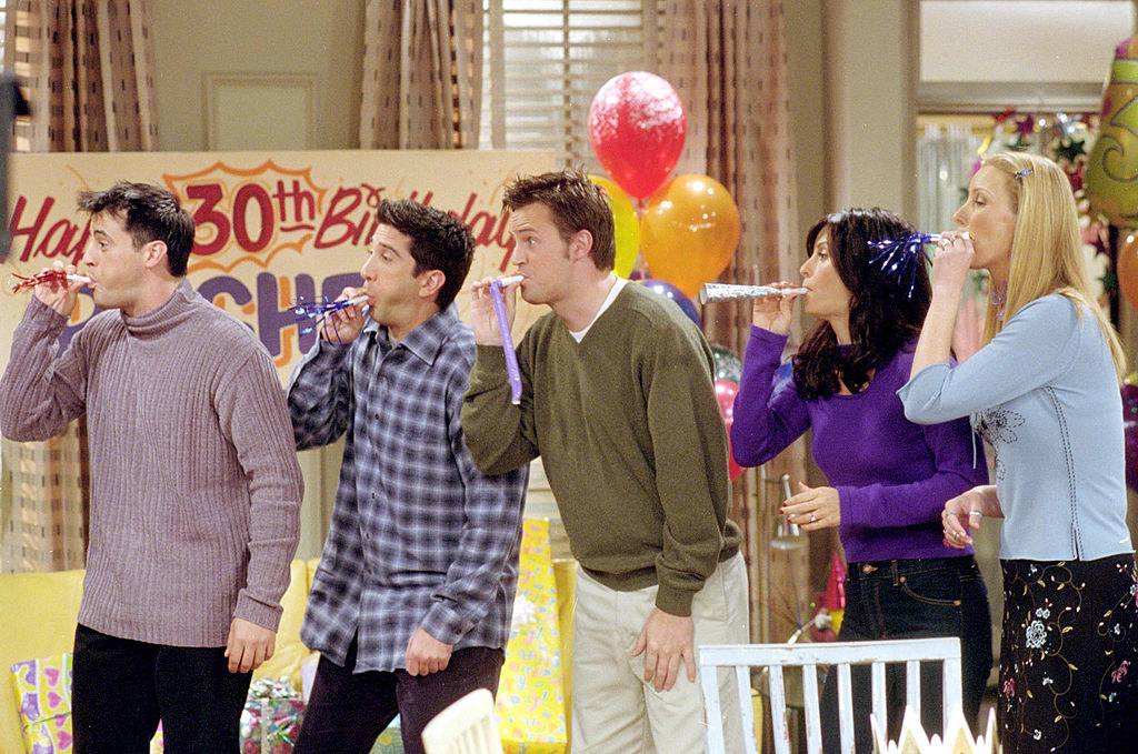 "The cast filming an episode of ""Friends"""