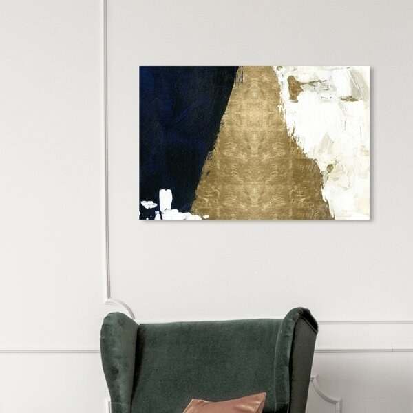 living area with top of arm chair visible and piece of canvas abstract wall art visible. all art has three general sections of black, gold, and white
