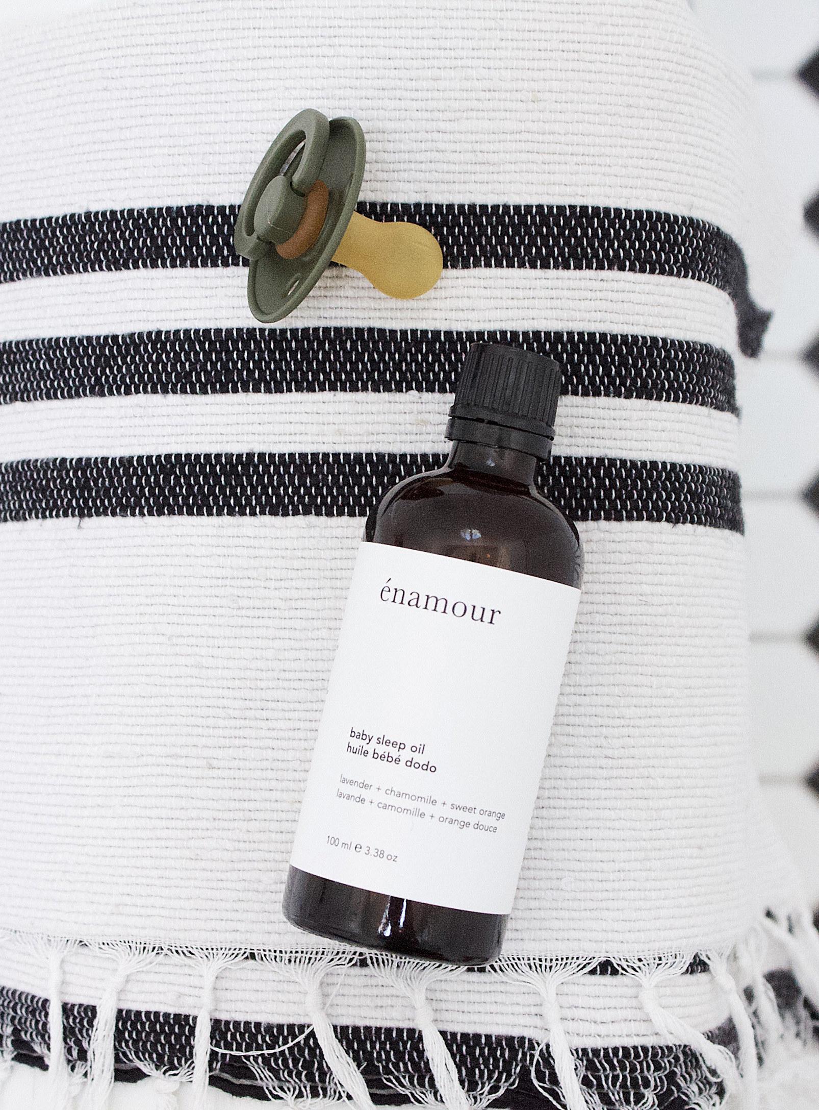 A bottle of sleep oil on a blanket