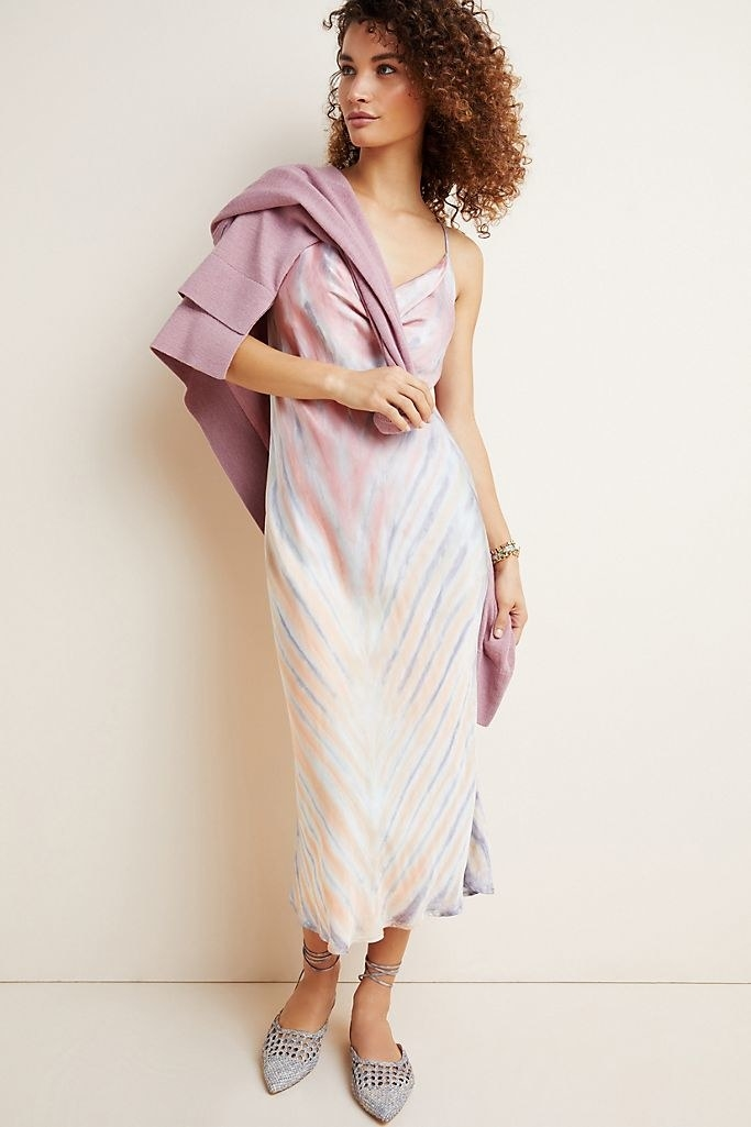 A model wearing the cowl neck slip maxi dress.