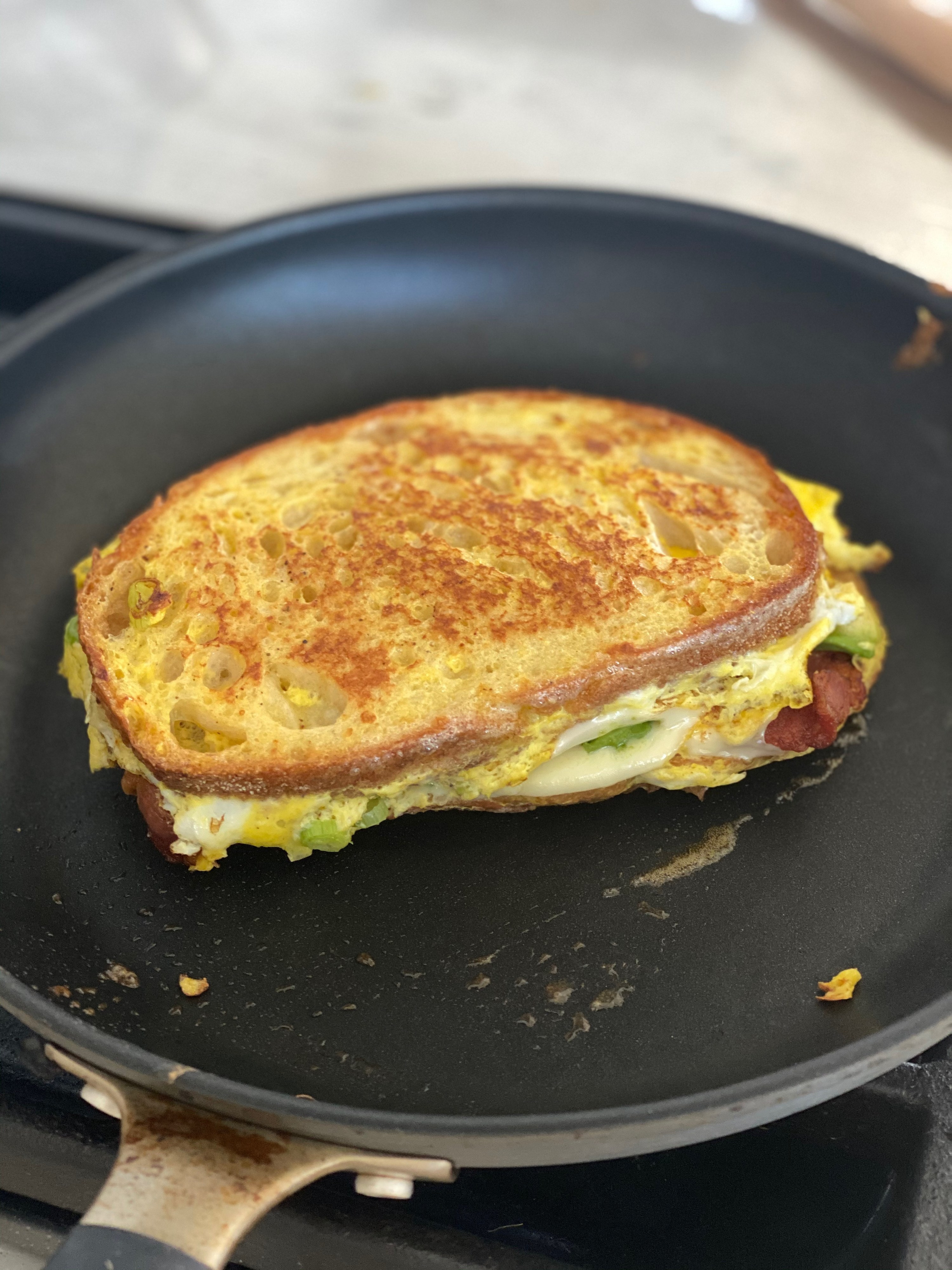 The sandwich, crisped up in the pan